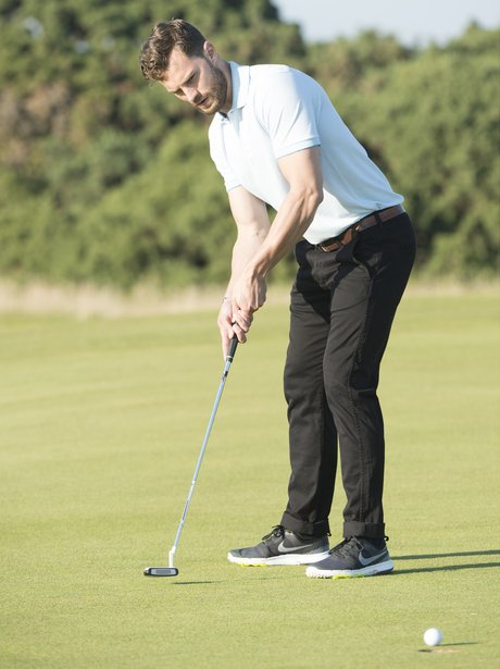Jamie Dornan playing golf