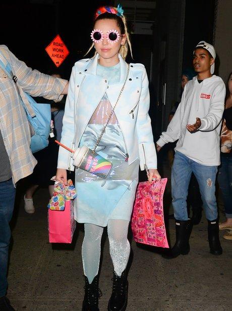 Miley Cyrus wearing flower glasses