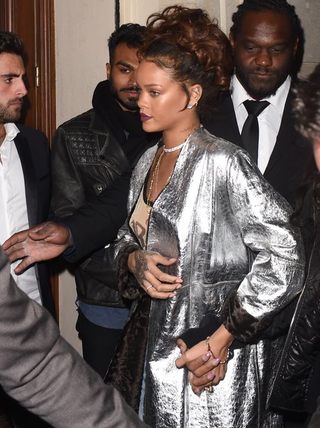 Rihanna wearing a silver jacket