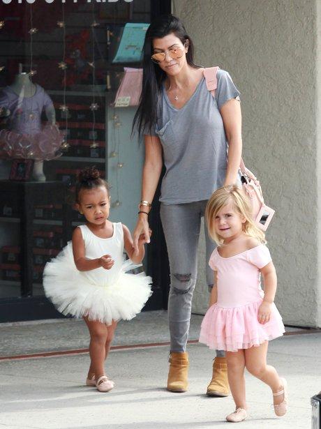 Kourtney Kardashian with North and Penelope