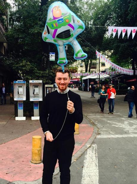 Sam Smith holding a balloon