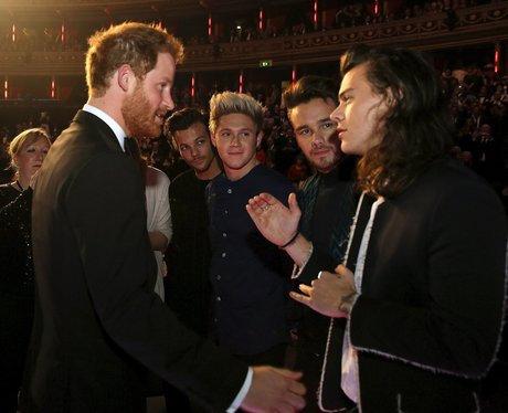 Prince Harry greets members of One Direction afte