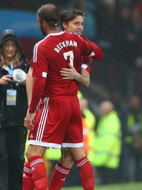 Brooklyn and David Beckham Hug Unicef Football Mat