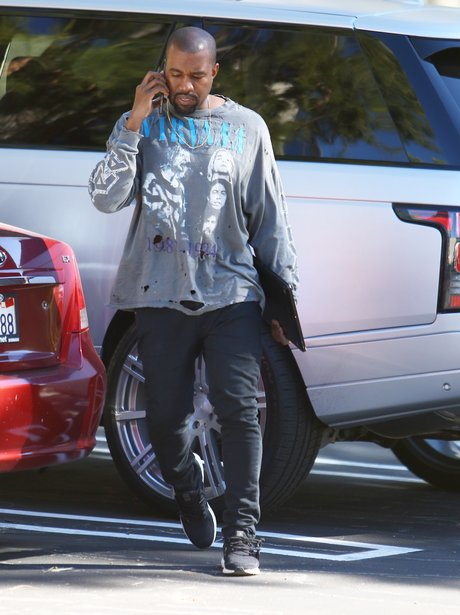 Kanye West on the phone wearing a Nirvanna top