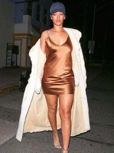 Rihann wearing a bronze metalic mini dress