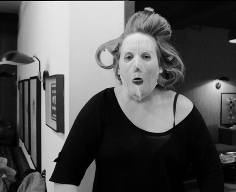 Adele with a face mask on
