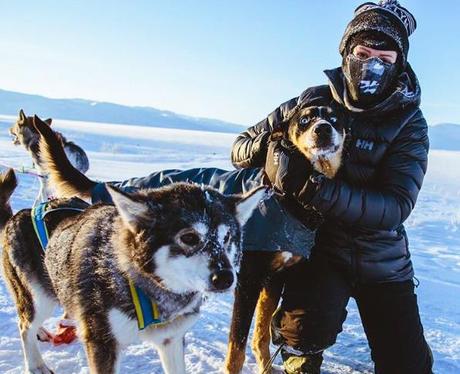 Ellie Goulding in the snow with huskies