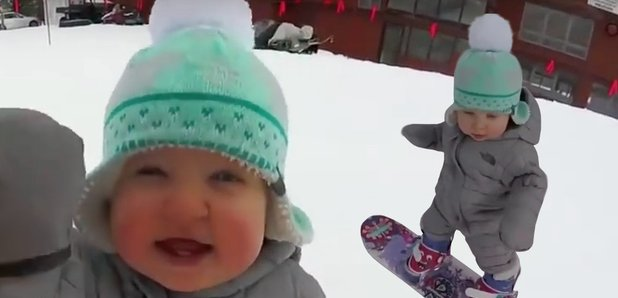 there s snow stopping this 1 year old from snowboarding down like a