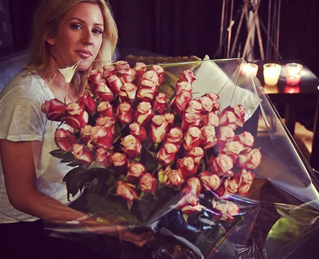 Ellie Goulding poses with HUGE bouquet of flowers