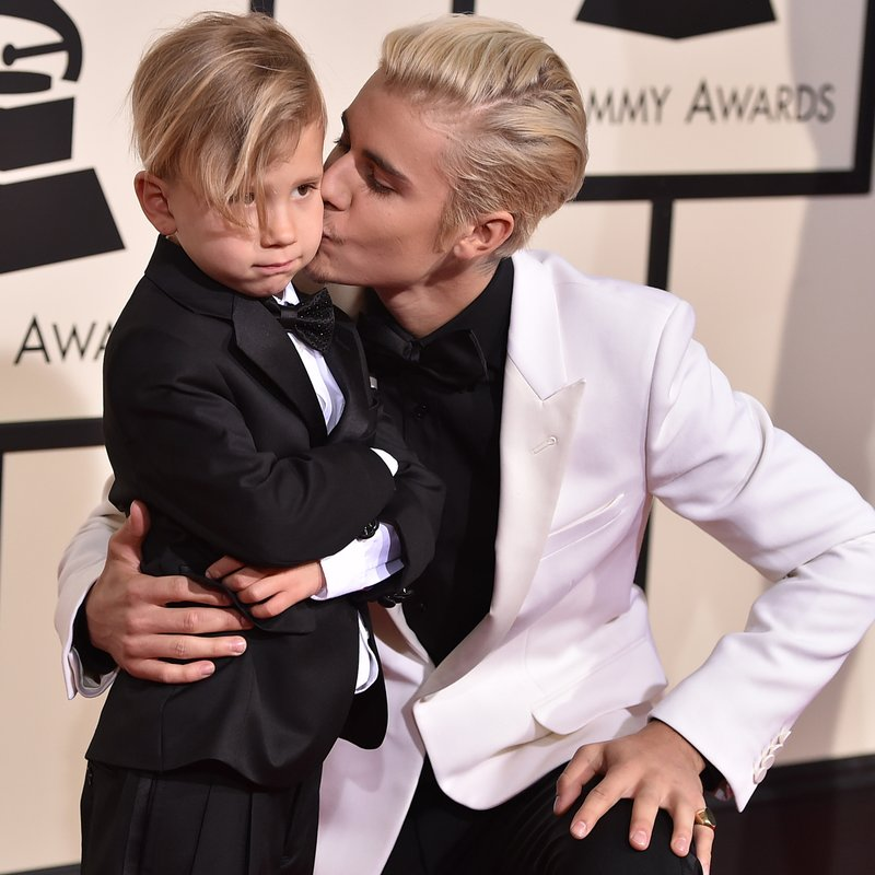 Justin Bieber with brother Jaxon at GRAMMYs 2016