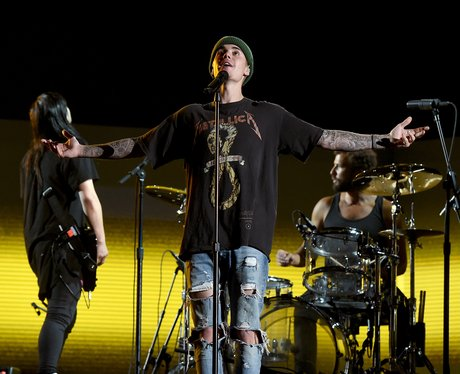 Justin Bieber rehearses onstage during The 58th Grammy's