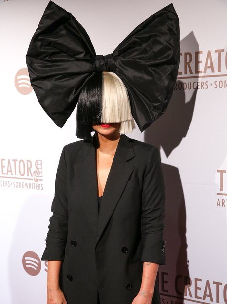 Sia? Is that you? OF COURSE it is - who else wears THAT wig? Sia attends Spotify Creators Party.Sia