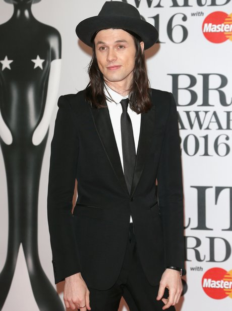 3fed8ddf96d Can t forget the hat! James Bay arrives on the red carpet looking dapper in smart  black suit.