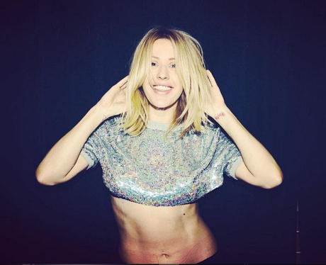 Ellie Goulding flashes abs