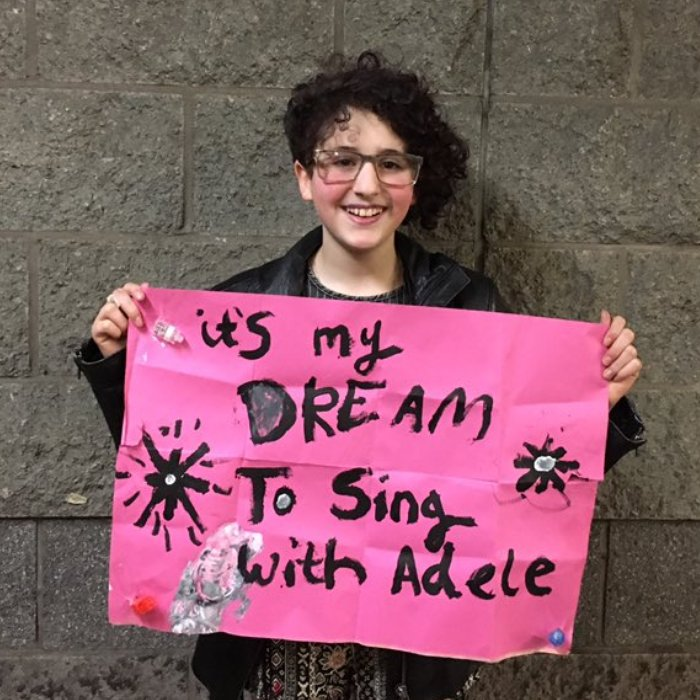 Emily Tamman Holding Poster Sang With Adele