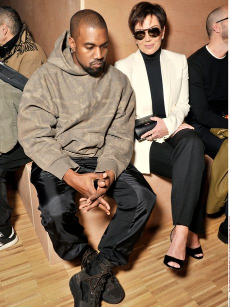 Kanye West looking grumpy at Givenchy