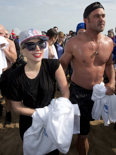 Lady Gaga and fiance take part in polar plunge