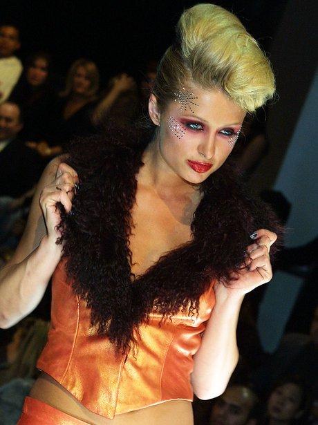 Paris Hilton with big hair during fashion show