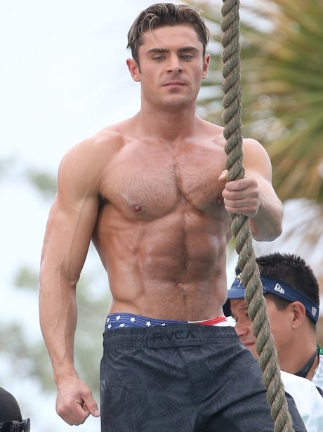 Zac Efron topless on set of Baywatch