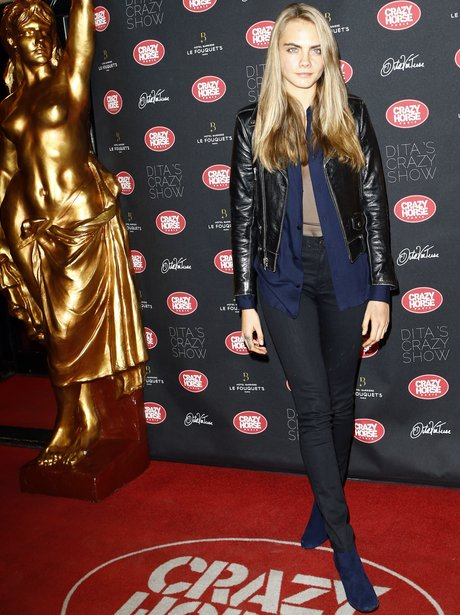Cara Delevingne walks the red carpet in Paris
