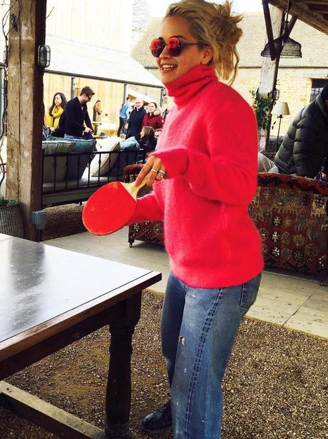 Rita Ora plays ping pong in red jumper