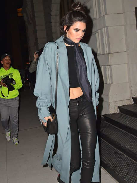 Kendall Jenner wears leather trousers to the launc