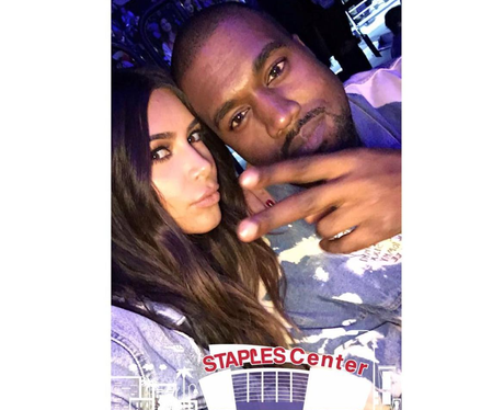 Kim Kardashian and Kanye West head to Beiber's con