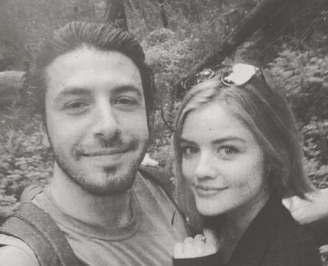 Lucy Hale goes for a walk in the woods with her bo