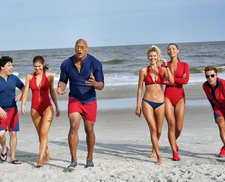 Baywatch cast walk along the beach
