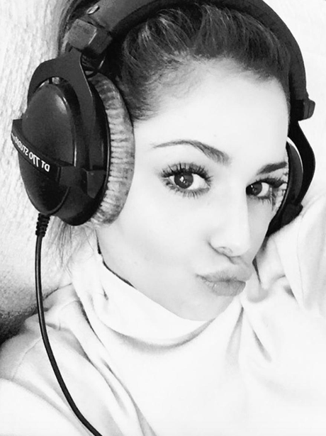 Cheryl teases that she is back in the studio with