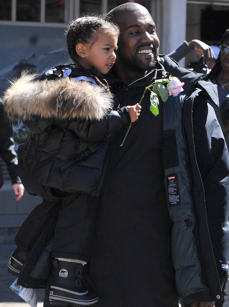 Kanye West and North West skiing