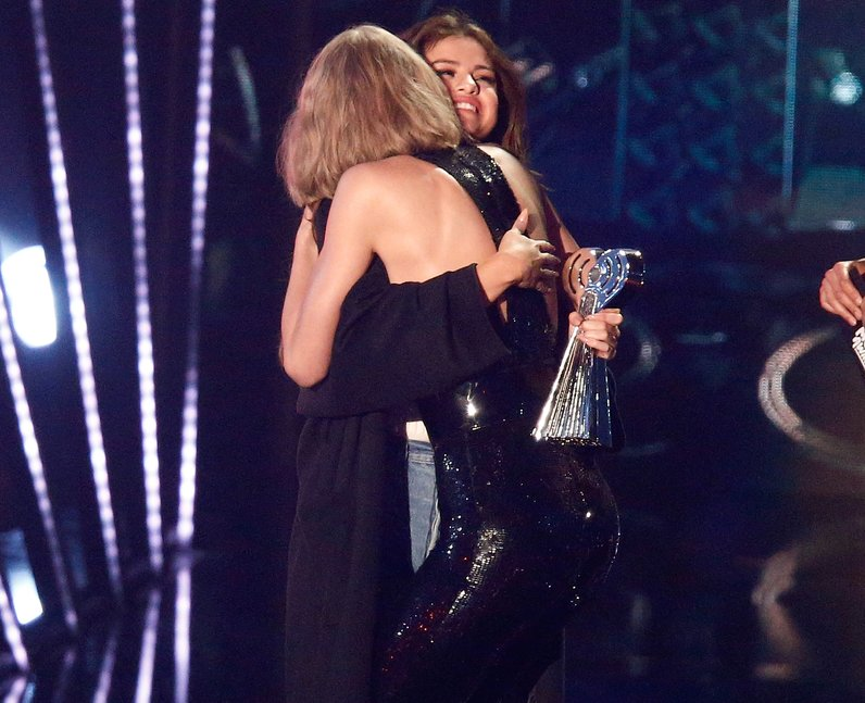 Taylor Swift and Selena Gomez hug on stage as she