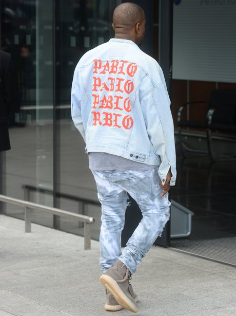 Kanye West steps out in Pablo jacket as he jets ou