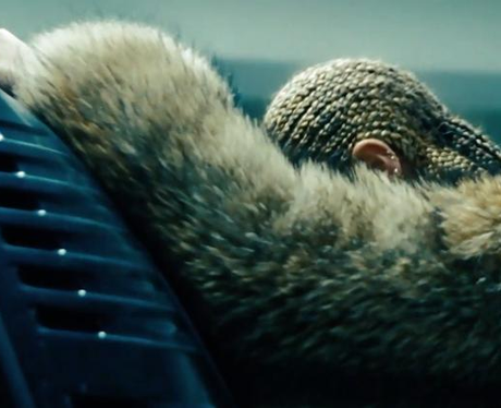 Beyonce leaning over car