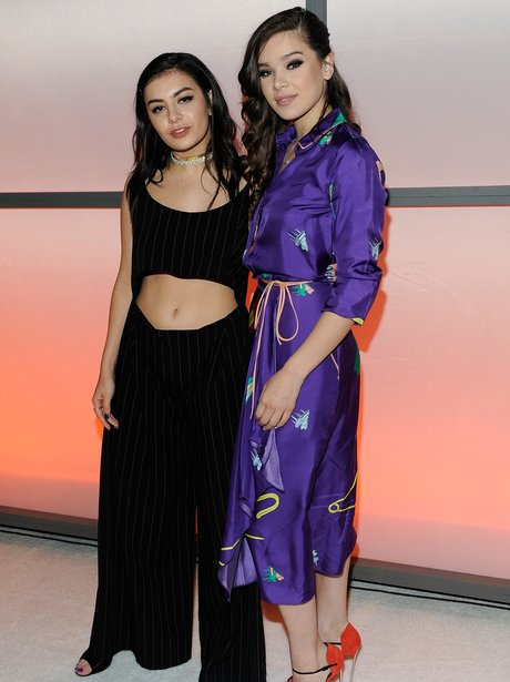 Hailee Steinfeld and Charli XCX cosy up at music a