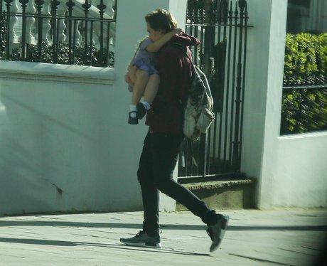 Brooklyn Beckham carries Harper