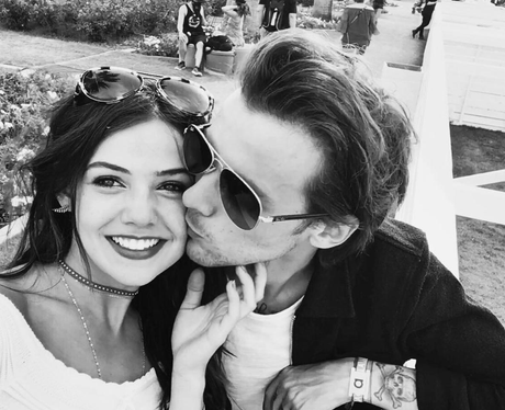 Danielle Campbell and Louis Tomlinson cosy up in r