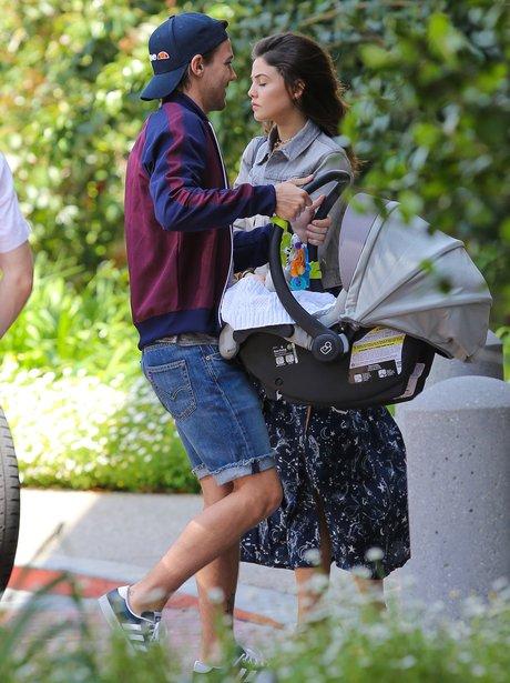 Louis Tomlinson carries baby Freddie whilst girlfr