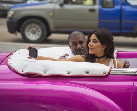 Kim Kardashian and Kanye West cruise around in a c