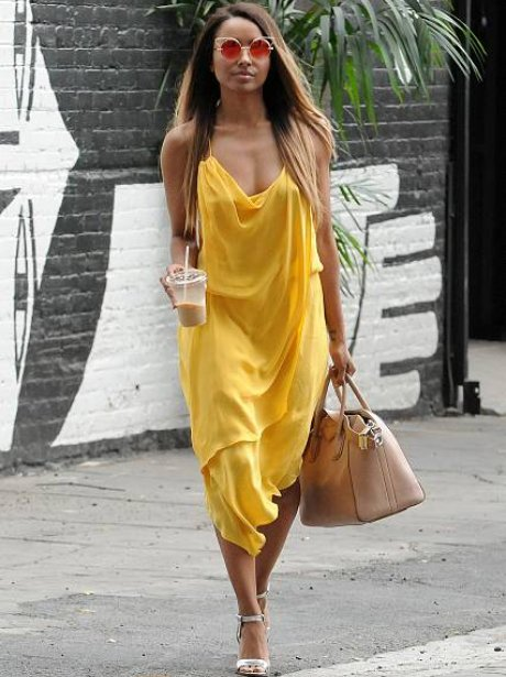 Kat Graham looks amazing in yellow dress
