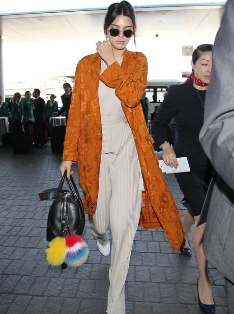 Kendall Jenner in knitted outfit with orange kimon
