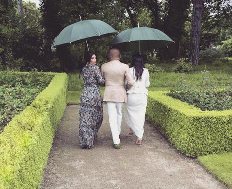 Kim and Kourtney Kardashian walk with Valentino on