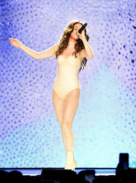 Selena Gomez in glitter bodysuit as she opens up h