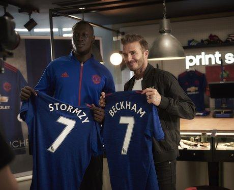 Stormzy and David Beckham holding football shirts