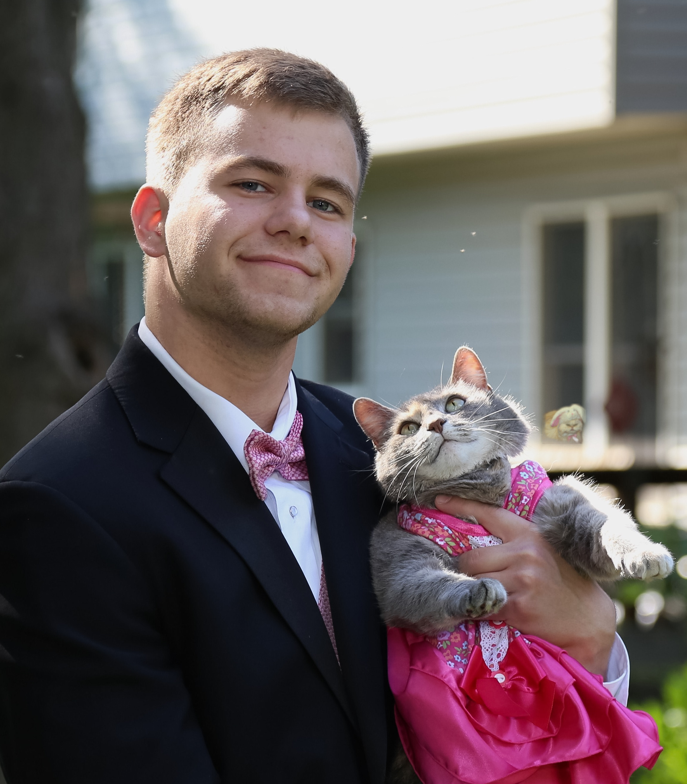 Guy takes his cat to prom