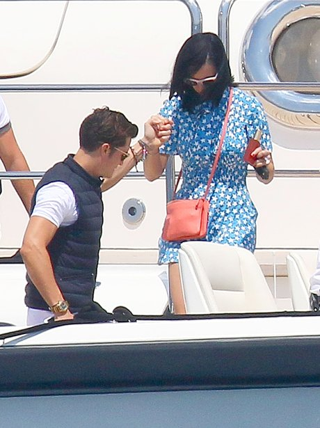 Orlando Bloom helps Katy Perry onto a boat