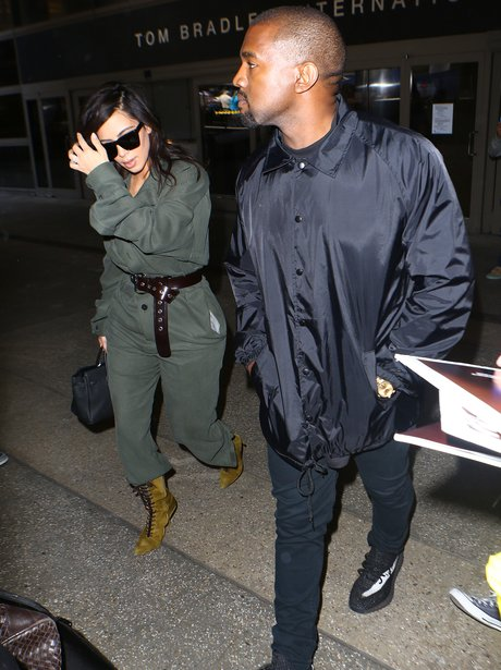 Kim and Kanye arrive back into LA airport after ce