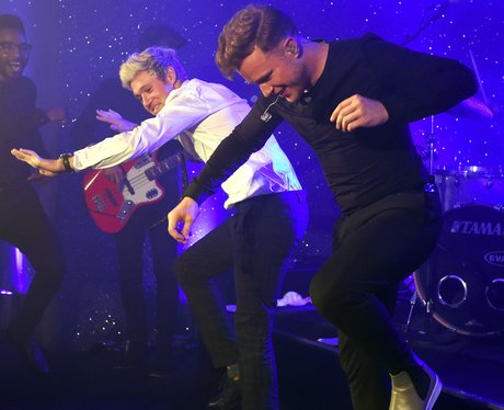 Niall Horan and Olly Murs dance on stage