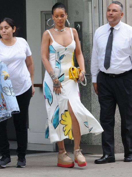 Rihanna steps out in pretty white dress
