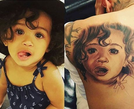 Chris Brown gets a tattoo of his daughter on his b